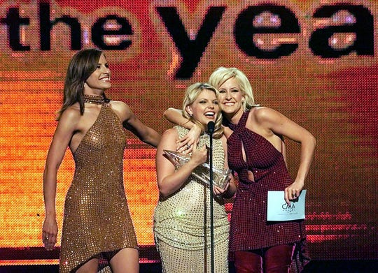 The Dixie Chicks celebrate after winning the Entertainer of the Year award during the CMA Awards show at the Grand Ole Opry House on Oct. 4, 2000.