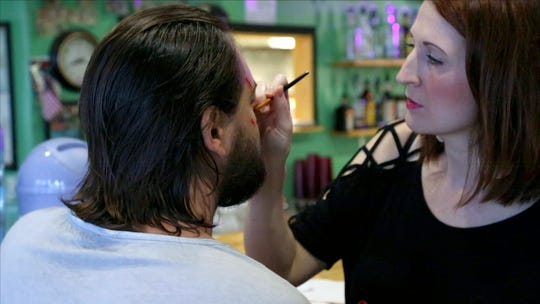 Charity Spencer applies Special Effects Makeup to Jason Bynum, the film's antagonist, during production.