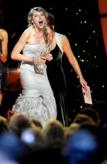 An overjoyed Taylor Swift accepts the Entertainer of the Year Award during the 45th annual CMA Awards show at Bridgestone Arena on Nov. 9, 2011. It was the second time she won the top prize.