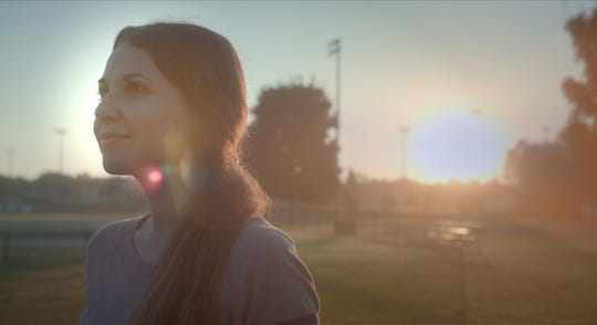 Lead actress Alex Sedlak is shown in a screen grab from the film that takes place during a montage as she is getting settled into the life and pace of Nolensville.