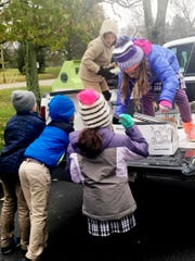 Lipscomb Academy third graders take in recyclables at last year's America Recycles Day event. This year's recycling day is Friday at the school.