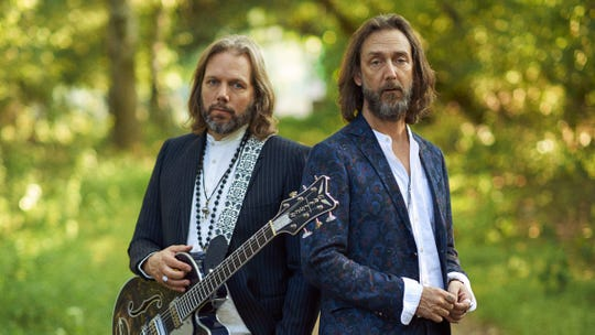 Rich Robinson, left, and Chris Robinson, right, of The Black Crowes