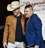 Dustin Lynch congratulates Justin Ebach as he is named Songwriter of the Year at the 2019 SESAC Nashville Music Awards Sunday, Nov. 10, 2019, in Nashville, Tenn.