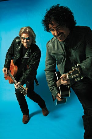 Daryl Hall, left, and John Oates play Riverbend Music Center Monday evening. Squeeze opens.