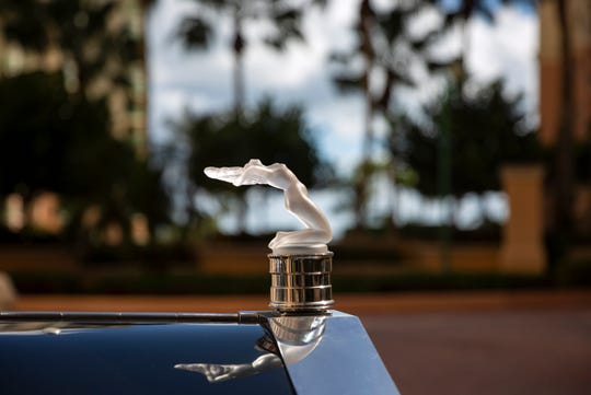 A  light up crystal Lalique glass hood ornament adorns  Sal and JoAnn Campo's 1954 Rolls Royce Silver Wraith as pictured, Monday, Nov. 11, 2019, at their home in Marco Island.