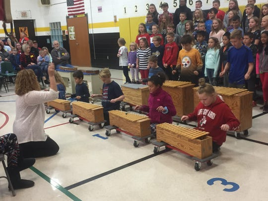"Etna Elementary students perform ""The Caisson Go Rolling Along,"" on Nov. 11."
