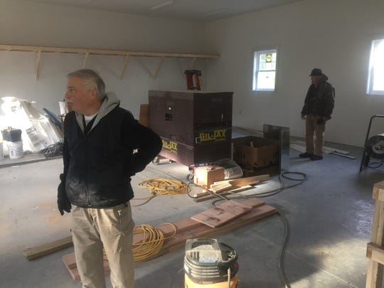 Granville Township Trustee conducts a tour of the nearly finished new structure at Maple Grove Cemetery that will include a service center, a chapel, and a wall for cremains.