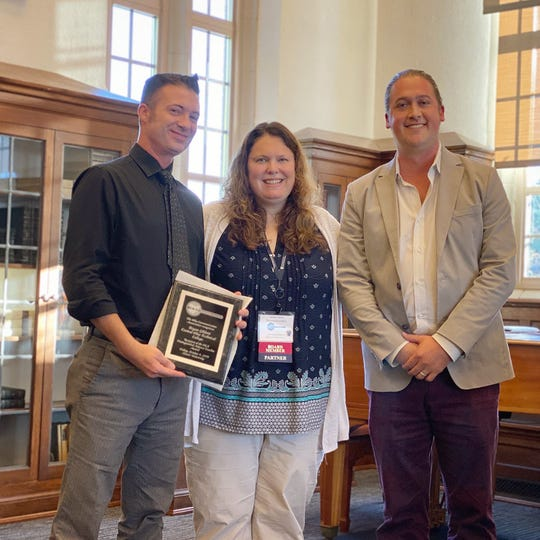 Bryan Ghiloni, left, with Ohio Communication Association Vice President Amber Ferris and COTC Assistant Professor James Jark.
