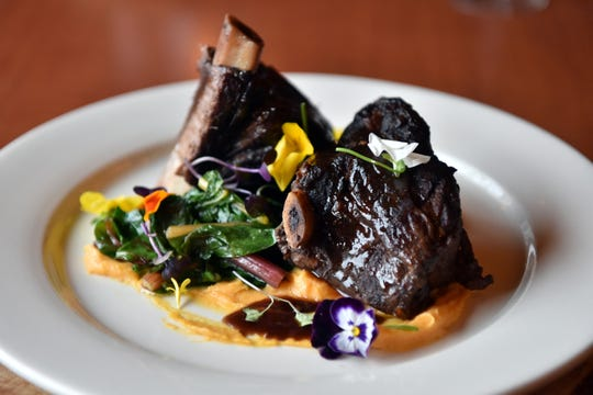 Vesta Wood Fired Pizza & Bar in East Rutherford. Charbroiled and braised short ribs served with burnt butter sweet potato purée and a cuisson barrel aged stout reduction.