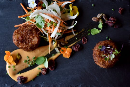 Vesta Wood Fired Pizza & Bar in East Rutherford. Crabcakes with lump crab, fennel, a carrot pistachio salad and smokey chili mostardo.