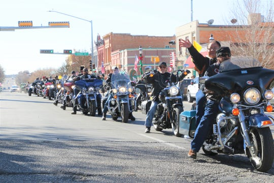 A motorcycle convoy of veterans during the annual Veterans Day Parade in Aztec on Veterans Day, Nov. 11, 2019.