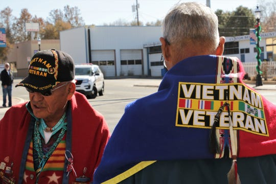 Vietnam veterans pass each other at the Veterans Day Parade in Aztec on Nov. 11, 2019, Veterans Day.