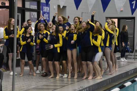 The South Lyon girls swim and team team won the Lakes Valley Conference for the third straight season.