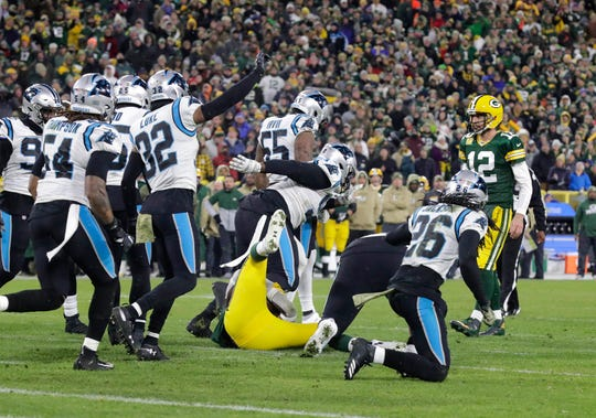 Green Bay Packers quarterback Aaron Rodgers (12) watches as Green Bay Packers running back Jamaal Williams (30) is pulled down to end a drive at the end of the first half during the Green Bay Packers vs. Carolina Panthers NFL game in Green Bay, Wisconsin, Sunday, November 10, 2019. RICK WOOD/MILWAUKEE JOURNAL SENTINEL