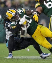 Green Bay Packers running back Jamaal Williams (30) against the Carolina Panthers during their football game Sunday, November 10, 2019, at Lambeau Field in Green Bay, Wis. The Packers defeated the Panthers 24-16.