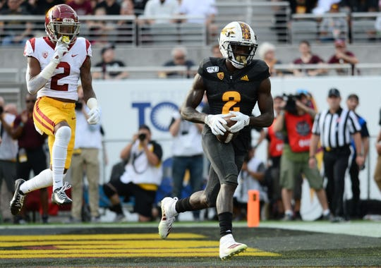 Arizona State Sun Devils wide receiver Brandon Aiyuk (2) scores a touchdown against USC Trojans cornerback Olaijah Griffin (2) during the second half at Sun Devil Stadium.