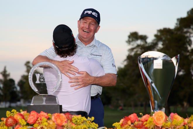 Winner of the Charles Schwab Cup, Scott McCarron (L) and winner of the Charles Schwab Cup Championship, Jeff Maggert (R) hug following the final round at Phoenix Country Club on November 10, 2019 in Phoenix, Arizona.