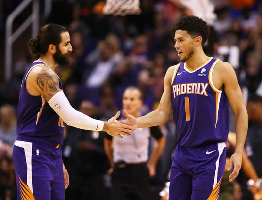 Phoenix Suns guard Ricky Rubio (11) and guard Devin Booker (1) during their win over the Brooklyn Nets in the second half on Nov. 10, 2019 in Phoenix, Ariz.