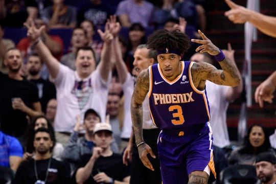 Phoenix Suns forward Kelly Oubre Jr. (3) celebrates after making a basket against the Brooklyn Nets in the first half at Talking Stick Resort Arena.
