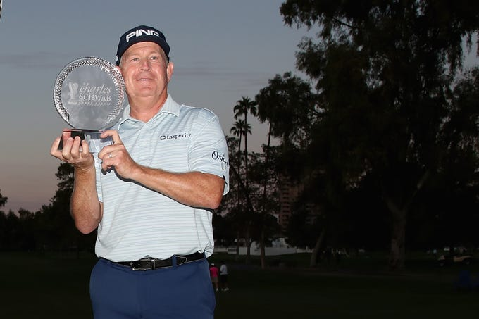 Winner of the Charles Schwab Cup Championship , Jeff Maggert poses with the trophy during the final round at Phoenix Country Club on November 10, 2019 in Phoenix, Arizona.