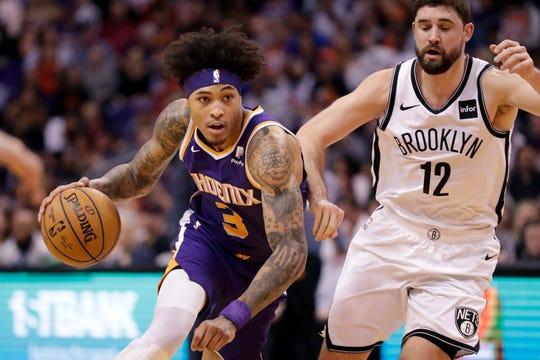 Phoenix Suns forward Kelly Oubre Jr. (3) drives as Brooklyn Nets forward Joe Harris (12) pursues during the first half of an NBA basketball game Sunday, Nov. 10, 2019, in Phoenix. (AP Photo/Matt York)