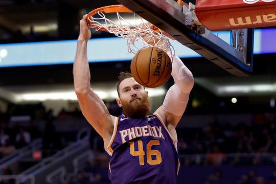 Phoenix Suns center Aron Baynes dunks against the Brooklyn Nets during the first half of an NBA basketball game Sunday, Nov. 10, 2019, in Phoenix. (AP Photo/Matt York)