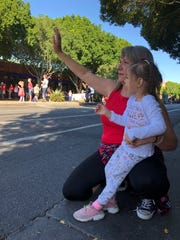 Teaching Willow the royal wave at the Veterans Day Parade in Tempe on Nov. 11, 2019.