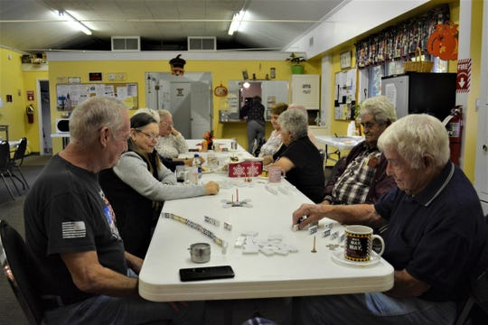 Locals spend time together before lunch is served at the Port Clinton Senior Center on Oct. 24. The senior center is one of the many collection spots for socks and blankets which will be given to home meal delivery clients.