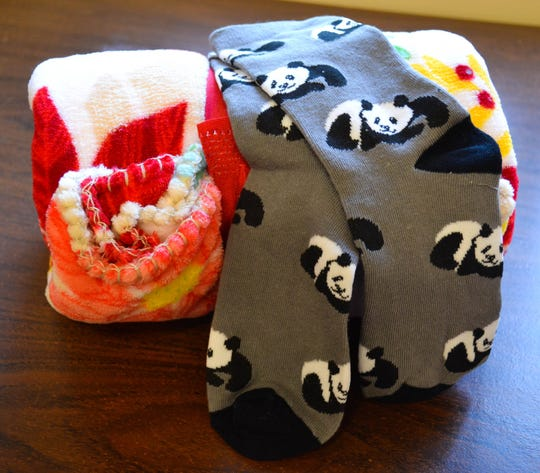7522 Fun and funky socks, like those shown here with a prepackaged blanket, are currently being collected for the Socks for Seniors program which provides new socks and blankets to local seniors who receive home meal delivery service.
