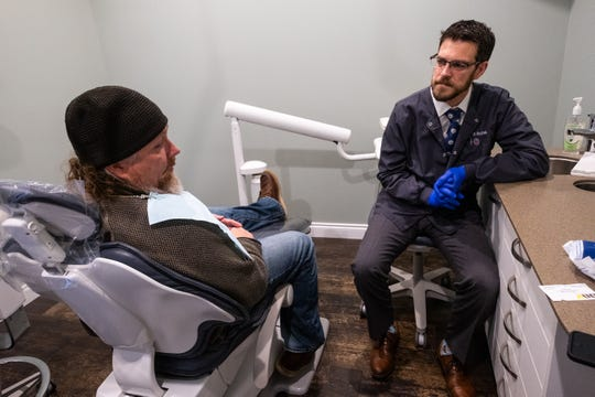 Dr. Matthew Bruzek, a U.S. Navy veteran, right, talks with James Lottner, who is an U.S. Air Force veteran, in an exam room in Riverview Family and Cosmetic Dentistry Monday, Nov. 11, 2019, in St. Clair. For the third year, Dr. Bruzek's office is offering free dental services to under or unemployed veterans, or veterans without insurance.