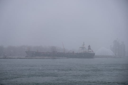 Snow falls over the St. Clair River Monday morning, Nov. 11, 2019, obscuring the view of a freighter docked in Sarnia.