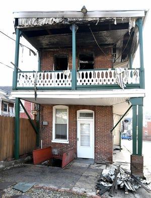 A house at 113 E. Philadelphia St. in York City was damaged by fire Monday, November 11, 2019. Bill Kalina photo