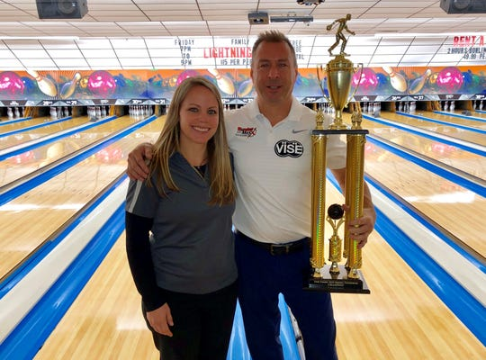 Kristen Gessner of Hanover Bowling Centre presents the York County Masters championship trophy to Richie Wolfe.