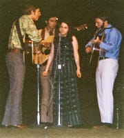 Dennis Johnson, second from left, plays on-stage with a young John Denver in 1969, an event that would lead to a life-changing experience.