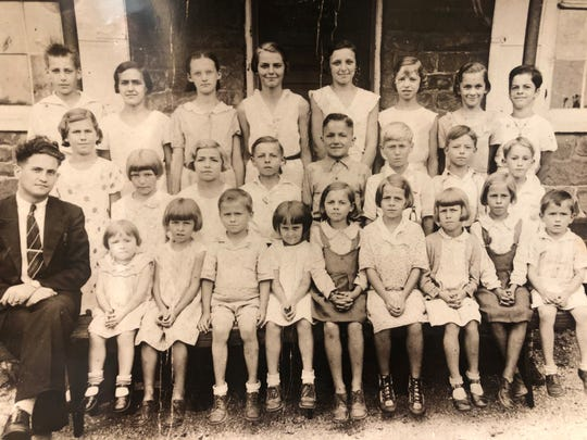 The Gross twins say that it's easy to find them in this photo; they're the ones without socks (they call them socklets). In the front row, Dottie is beside the boy on the far right. Vert is fourth in from the right in the front row. They attended a school in Dover with multiple ages in one classroom.