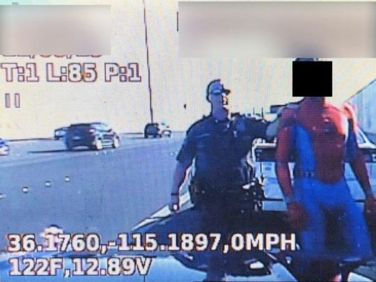 Spiderman landed in jail Saturday for traffic warrants.