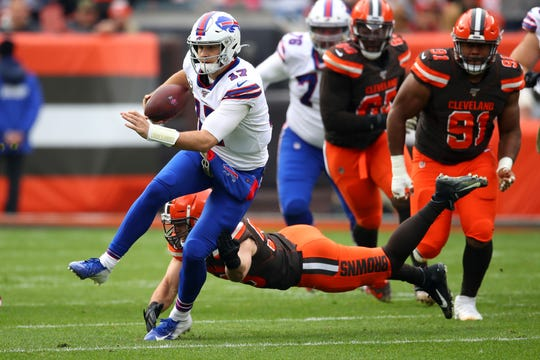 Josh Allen #17 of the Buffalo Bills runs for a first half first down past the tackle of Joe Schobert #53 of the Cleveland Browns at FirstEnergy Stadium on November 10, 2019 in Cleveland, Ohio.