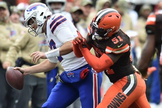 Cleveland Browns linebacker Mack Wilson (51) knocks Buffalo Bills quarterback Josh Allen (17) out of bounds during the first half at FirstEnergy Stadium.