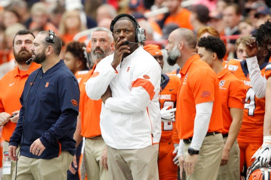 Syracuse head coach Dino Babers, center, looks at the scoreboard during the third quarter of a 58-27 loss to Boston College on Nov. 2.