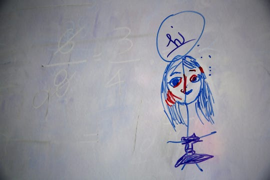 A face drawn by one of Lucy's daughters draws while speaking about their experiences in Keizer on Nov. 11, 2019. The family is homeless while Lucy is in treatment for a drug addiction.