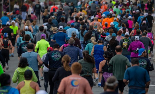 A wave of runners make their way through the 13.1-mile course during the Monterey Bay Half Marathon in Monterey, Calif. on Sunday, Nov. 10, 2019.