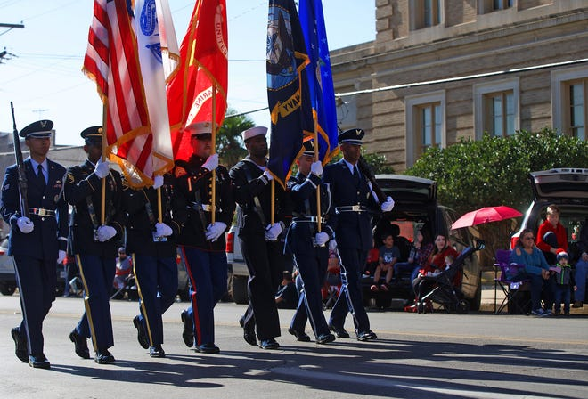 The military color guard marches in the Veterans Day parade in San Angelo on Saturday, Nov. 9, 2019.