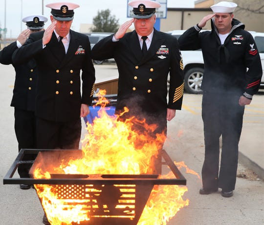 Service members from Goodfellow Air Force Base and the United States Navy Detachment participate in a flag-retirement ceremony at the Veribest ISD flagpole on Veterans Day on Monday, Nov. 11, 2019.