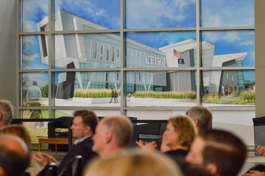 An image of what the new Louisiana Tech Research Institute (LTRI) facility at the National Cyber Research Park will look like when completed is displayed in windows on Monday, Nov. 11, 2019, during an announcement of $10 million in capital outlay for its construction.