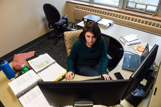 Argus Leader reporter Shelly Conlon pores over binders full of documents as she reports on complications regarding  deaf education across the state on Tuesday, Oct. 1, in the newspaper's office in Sioux Falls.