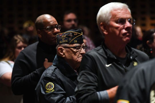 A member of the American Legion Honor Guard holds his hand to his heart during the singing of the National Anthem at a Veterans Day program on Monday, Nov. 11, at Lincoln High School.