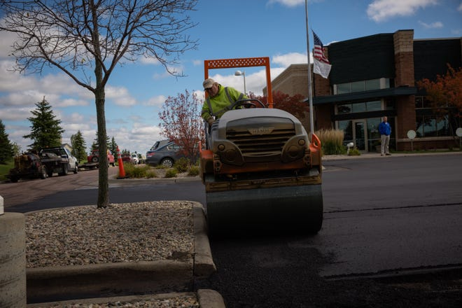 Crews use Poet Nutrition's Jive product to restore asphalt in front of the company's northern Sioux Falls offices.
