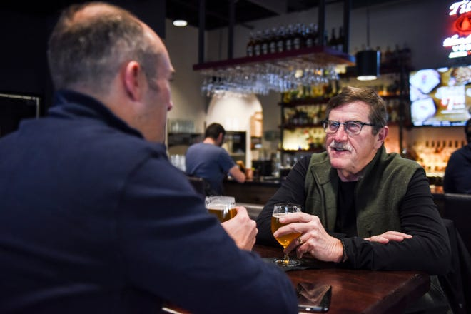 Roger Nikodym and Matt Nikodym have beers at the bar located inside JJ's Wine, Spirts and Cigars on Friday, Nov. 8, 2019 in Sioux Falls.