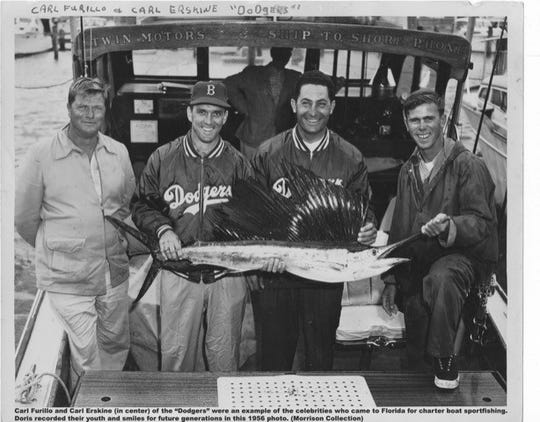 Members of the Dodgers, Carl Furillo and Carl Erskine remember the day with this Doris Barnes ' photo.