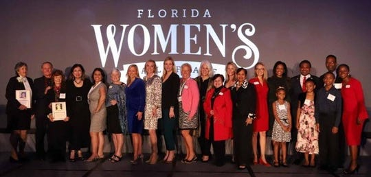 The 2019 Women's Hall of Fame inductees with the judges from the ceremony on Oct. 28, in Orlando. To far left, holding her picture is Dr. Judith Ann Bense, of Pensacola, beside Martha Saconchik- Pytel and Larry Pytel, receiving the picture for Doris Barnes (deceased), of North Miami, and the seven-member family accepting for Mildred Wilborn Gildersleeve of Lake Worth.